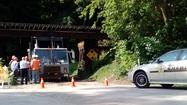 Trash truck damages rail bridge near Hudson Lake