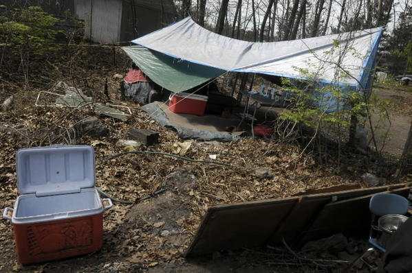 "Manchester business owners and town officials have discussed what to do about people living in a patch of land between the Manchester Parkade and Broad Street known as ""Tent City."""