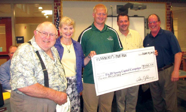 Flannery's Pub Run organizers announced the Fix JB Sports donation at the June 10 Tuscarora School Board meeting in Mercersburg, Pa. Shown, from left, are Fix JB Sports Committee members John Stoner and Marianne Quinn; and Pub Run organizers Jason Cotton, John Flannery and Vernon McCauley.
