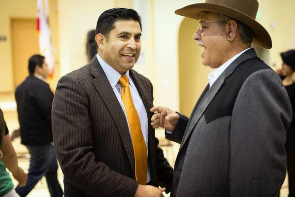 Salinas City Councilman Jose Casteneda, left, greets Monterey County Board of Education member David Gomez-Selina at the dedication of a new elementary school in east Salinas named for Tiburcio Vasquez, a controversial 19th century figure.