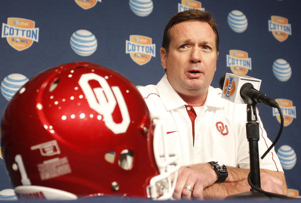 Oklahoma Sooners coach Bob Stoops answers questions from the media during the Cotton Bowl Media Day at Cowboys Stadium Sunday, December 30, 2012.