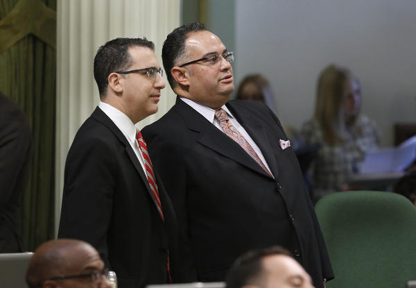 Assemblyman Bob Blumenfield (D-Sherman Oaks), left, chairman of the Assembly Budget Committee, and Assembly Speaker John Perez (D-Los Angeles) watch as the votes for the state budget are posted at the Capitol last week.