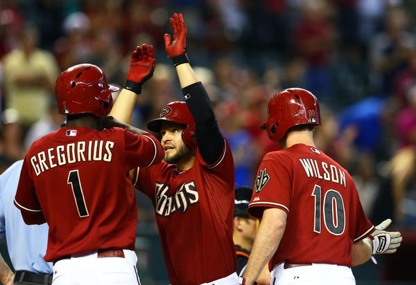 Jun. 19, 2013; Phoenix, AZ, USA: Arizona Diamondbacks batter Cody Ross (center) celebrates with Josh Wilson (right) and Didi Gregorius after hitting a three run pinch hit home run in the eighth inning against the Miami Marlins at Chase Field. Mandatory Credit: Mark J. Rebilas-USA TODAY Sports ORG XMIT: USATSI-122470