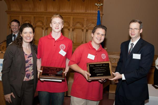 8th grade winners Joseph Bechard & Artur Zielinski (1st Place) from Sacred Heart in New Britian, along with Deputy Commissioner of Energy for DEEP Katie Dykes and Jamie Howland, First Vice Chairperson of the CT Energy Efficiency Board (QB76400)