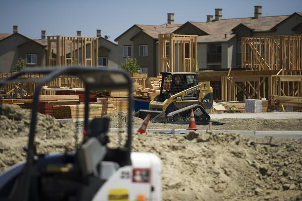 Expect the construction sector to continue its hiring surge when California issues its jobs report Friday. Above, contractors work on home construction in San Ramon, Calif., this month.