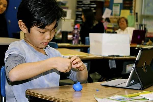 Wescott School third-grader Branden Chi shared his knowledge with faculty of claymation and IStop Motion using his iPad on April 8.