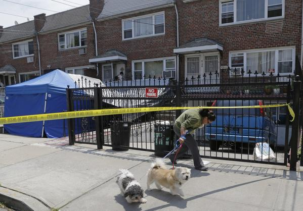 "A woman ducks under crime scene tape in front of a New York city house once occupied by a famous gangster in New York on Tuesday. The work started Monday at the home of James Burke, a Lucchese crime family associate known as ""Jimmy the Gent."" He was the inspiration for Robert De Niro's character in the 1990 Martin Scorsese movie ""Goodfellas."" Burke died behind bars in 1996, two decades after authorities say he masterminded a nearly $6 million robbery at New York's Kennedy Airport, one of the largest cash thefts in American history. The Queens house is still owned by the Burke family, but others now live there."