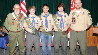 Three new Eagle Scouts from the same troop in Confluence were honored recently. From left are Dwayne Welling, who served in the Scouts for 67 years; new Eagles Evan Nogroski, Keith Russell and Scott Miltenberger, and Scoutmaster Tom Holliday.