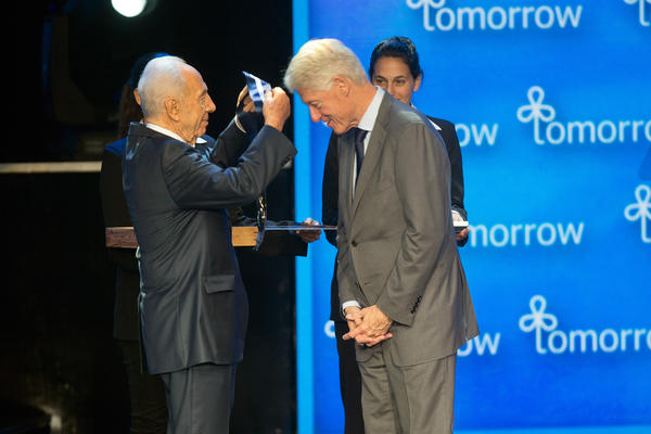 Israeli President Shimon Peres presents former President Bill Clinton with the presidential Medal of Freedom, Israel's highest distinction, Wednesday in Jerusalem.