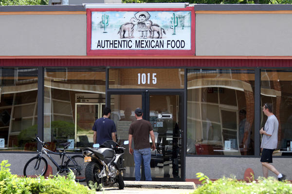 Lunchtime diners read the handwritten signs saying that the Los Burritos Mexicanos restaurant in Lombard is closed on Monday. The restaurant remained closed as DuPage County Health Department continue to investigate E. coli cases.