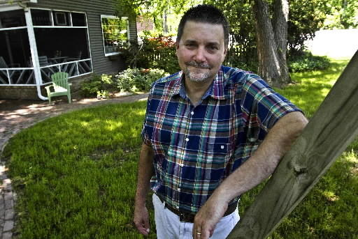 Allen Weber of Hampton, the 2013 Daily Press Poet Laureate, stands in the backyard of his Hampton home.