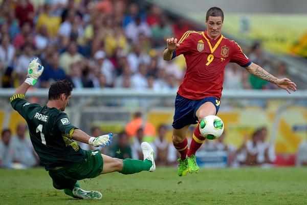 Fernando Torres of Spain goes past Mickael Roche of Tahiti on his way to scoring one of his four goals during his team's 10-0 victory Thursday.