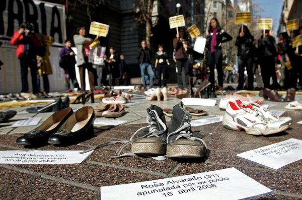 At a demonstration in Santiago, Chile, pairs of shoes represent women who have been the victims of sexual violence.