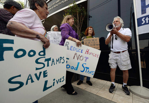 Tom Camarello of Progressive Democrats of America and other activists rally in Los Angeles on Monday to urge Rep. Henry Waxman (D-Beverly Hills) to oppose a House farm bill that would reduce spending on food stamps and other services for the poor.