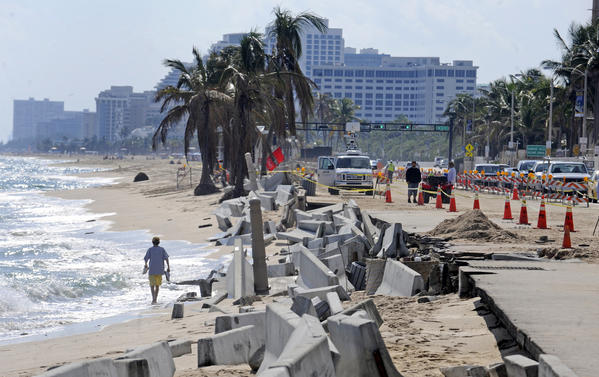Barricades line the beach next to crumbling sidewalks and seawalls along State Road A1A just north of Sunrise Blvd.
