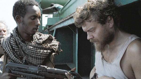 "Abdihakin Asgar, left, and Pilou Asbaek in ""The Hijacking."""