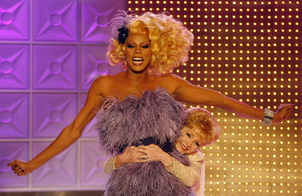 RuPaul is hugged by guest judge Debbie Reynolds.