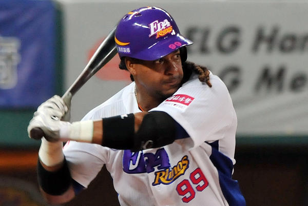 Former Red Sox slugger Manny Ramirez swings during his debut game after joining EDA Rhinos in March, in Taiwan's southern Kaohsiung baseball stadium.