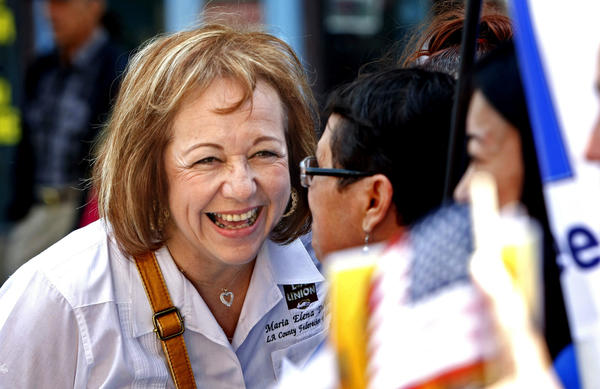 Maria Elena Durazo, head of the Los Angeles County Federation of Labor, greets marchers with her characteristic easy smile before the start of L.A.'s May Day parade along Broadway. Durazo is a champion of immigrant laborer rights and a tireless
