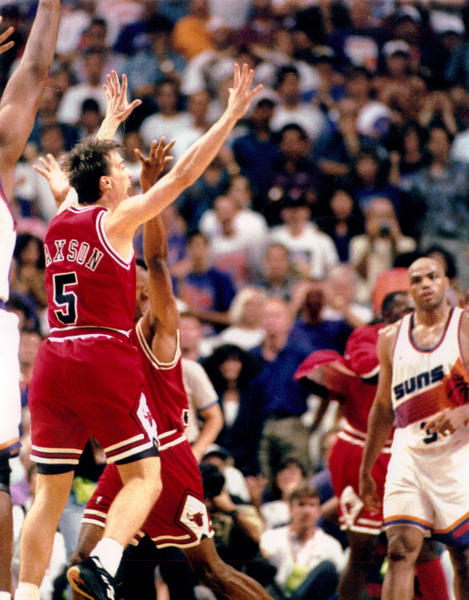 Chicago Bull John Paxson, left, hits the championship-winning basket against the Pheonix Suns on June 20, 1993 during Game 6.