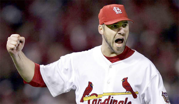 Cardinals pitcher Chris Carpenter's rehabilitation from nerve issues on the right side of his body has suffered a set back after the right-hander injured his lower back in a bullpen session.