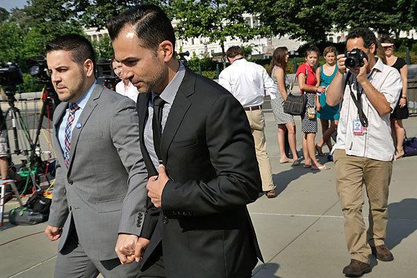 Proposition 8 plaintiffs Jeffrey Zarrillo, left, and Paul Katami arrive at the Supreme Court on Thursday.