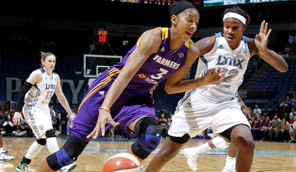 Candice Parker drives against Maya Moore during a meeting of the Sparks and Minnesota Lynx last season.