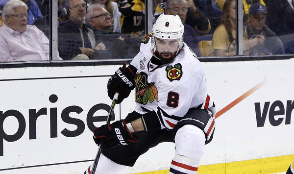 Blackhawks defenseman Nick Leddy carries the puck against Bruins center Patrice Bergeron during the third period in Game 3 of the 2013 Stanley Cup Final at TD Garden.