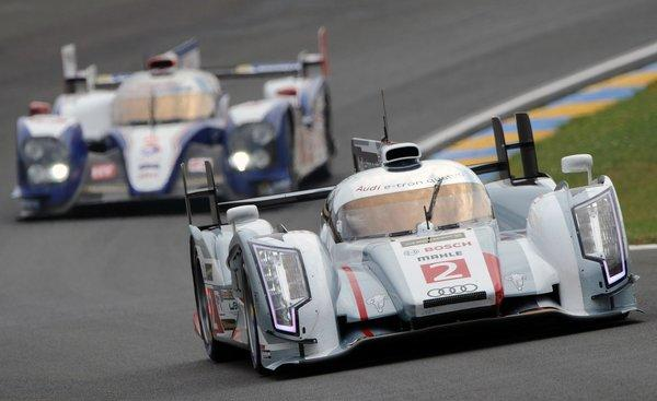 The Audi R18 E-Tron Quattro Hybrid driven by Scotland's Allan McNish competes ahead of the Toyota TS030 Hybrid driven by Austria's Alexander Wurz during the free practice session of the 90th edition of the 24 Hours of Le Mans in western France.