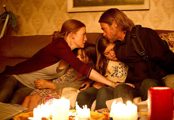 "Mireille Enos as Karin Lane, Sterling Jerins as Constance Lane, Abigail Hargrove as Rachel Lane, and Brad Pitt as Gerry Lane in a scene from ""World War Z."""