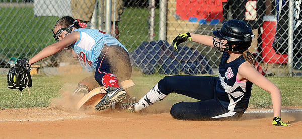 Halfway's Brianna Campbell gets caught up in the base as it came out from Sharpsburg's Ellie Connelly sliding safely into it Thursday.