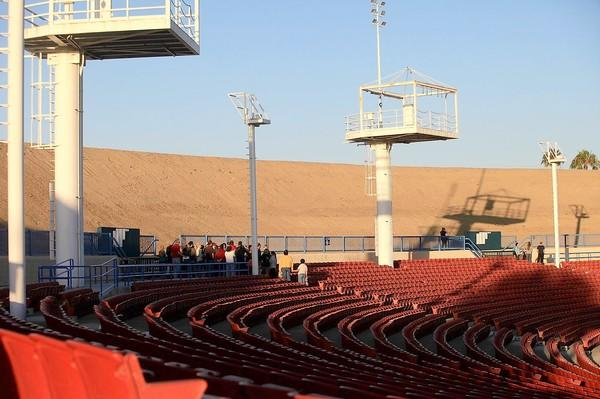 During an open-house tour Wednesday, visitors walk near a portion of the Pacific Amphitheatre's newly excavated dirt berm, which, according to Orange County Fairgrounds officials, will help buffer the venue's noise level.