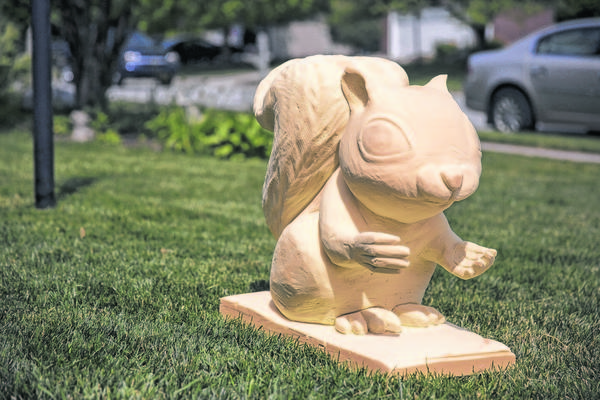 This prototype of the squirrel statue soon to be seen around Hamilton county is seen on the lawn of Gary Harling in Fishers, Ind., Wednesday, June 12, 2013. The Great Squirrel Art Stampede aims to install decorated squirrel statues at key locations throughout the county, tying together area landmarks to draw visitors and educate residents.