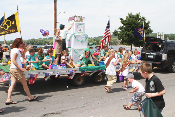 Members of the East Jordan Girl Scout Troupe 10364 were a few of many to march through town last June for the East Jordan Freedom Festival. The grand parade is scheduled for 3 p.m. this Saturday, June 22.
