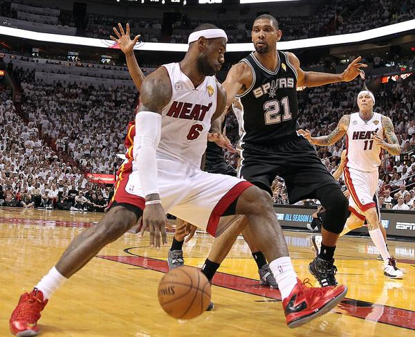 The Miami Heat's LeBron James (6) drives to the basket against San Antonio Spurs' Tim Duncan (21) in the third quarter of Game 7 of the NBA Finals at the AmericanAirlines Arena in Miami, Florida, on Thursday, June 20, 2013.
