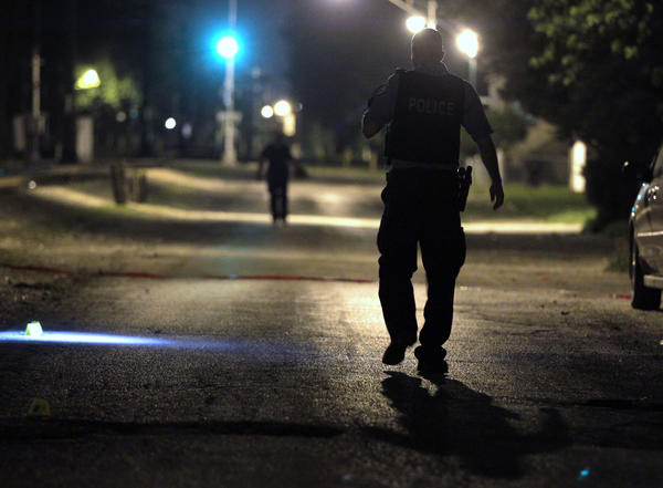 Chicago Police investigate the shooting of a 15-year-old boy at 121st Street and Perry Avenue overnight in Chicago.