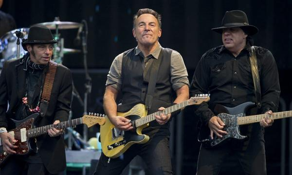 Bruce Springsteen, center, with guitarists Nils Lofgren, left, and Steve Van Zandt, dedicated the album 'Born to Run' to actor James Gandolfini during a show Wednesday in Coventry, England.