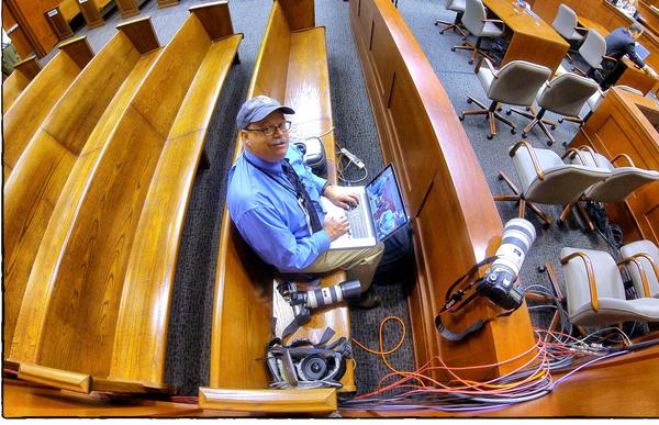 Orlando Sentinel senior photographer Joe Burbank works from the pool camera position on the front row of the George Zimmerman trial, in Seminole circuit court, in Sanford, Fla., Tuesday, June 18, 2013. (Joe Burbank/Orlando Sentinel) newsgate CCI B583002455Z.1