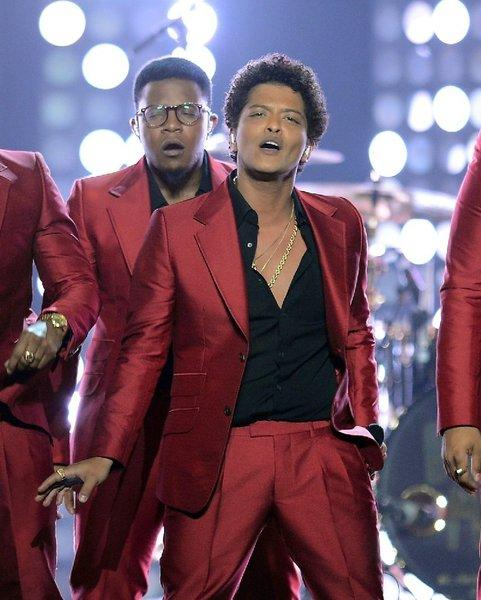 Bruno Mars performs onstage during the 2013 Billboard Music Awards. Italian luxury brand Dolce & Gabbana has announced it is outfitting him for his world tour, which kicks off this weekend in Washington, D.C.