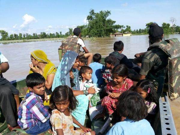 Indian army troops engage in rescue operations in flood hit areas in Pilibhit, Uttar Pradesh, India, June 21, 2013.