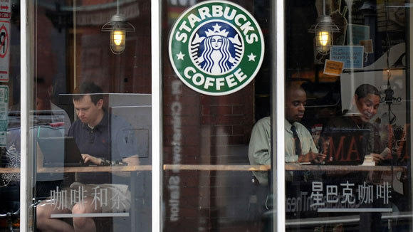 Customers take advantage of the Wi-Fi at a Starbucks in Washington, D.C., in a 2012 file photo.