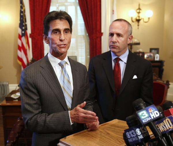 State Sen. Mark Leno (D-San Francisco), left, and Senate leader Darrell Steinberg (D-Sacramento) talk to reporters at the Capitol in Sacramento.