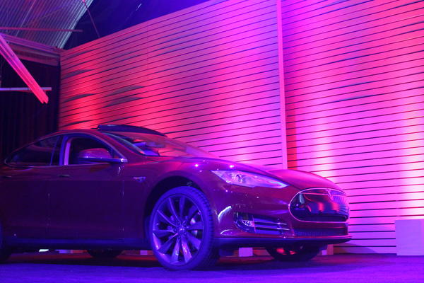 A Tesla Model S waited off to the side of the huge stage inside the carmaker's Hawthorne studios Thursday night, waiting for its debut as demo car for the new battery swap system.