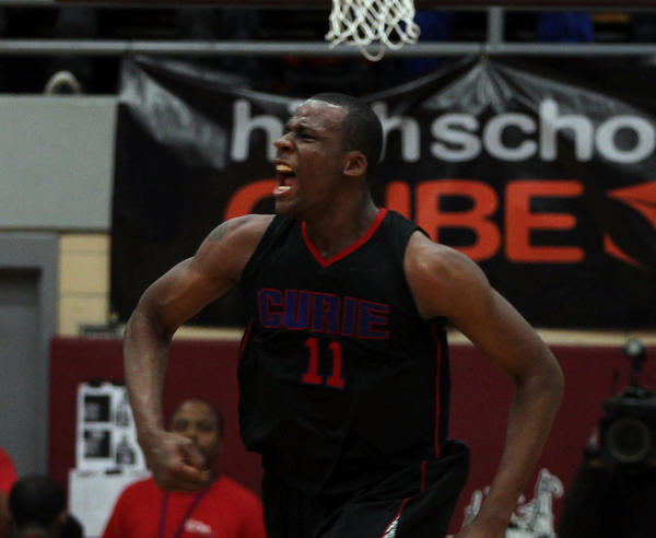 Curie's Cliff Alexander celebrates a basket during IHSA Class 4A Sectional semifinal on March 7.