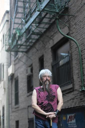 Sukie De La Croix stands under a fire escape at 20 East Goethe St. Many years ago, people escaped through there from a police raid of a private party