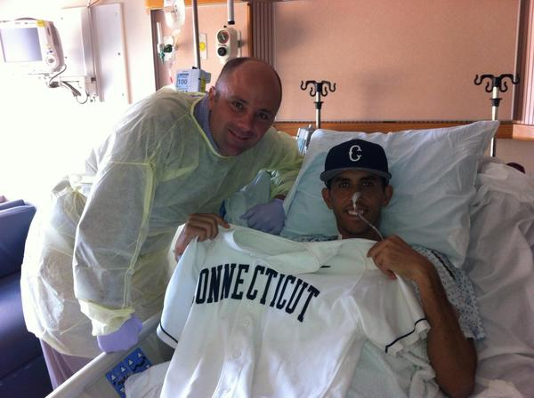 UConn baseball coach Jim Penders, left, visits Mike Galati in the hospital.