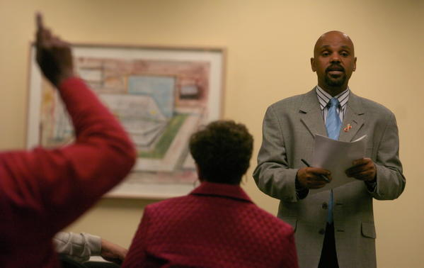 Lloyd Kelly conducts an AIDS issue meeting on Chicago's southside in 2006. Kelly is an AIDS activist instrumental in the creation of the African American HIV/AIDS Response Act which took effect Jan. 1, 2006.