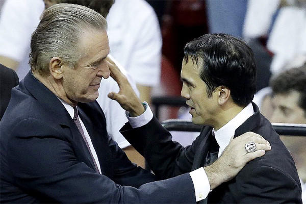 Miami Heat President Pat Riley, left, speaks to Coach Erik Spoelstra after Game 7 of the NBA Finals.