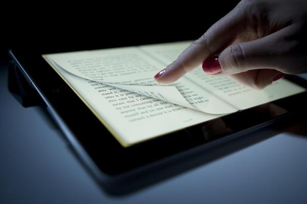 A digital book is displayed on an Apple Inc. iPad.