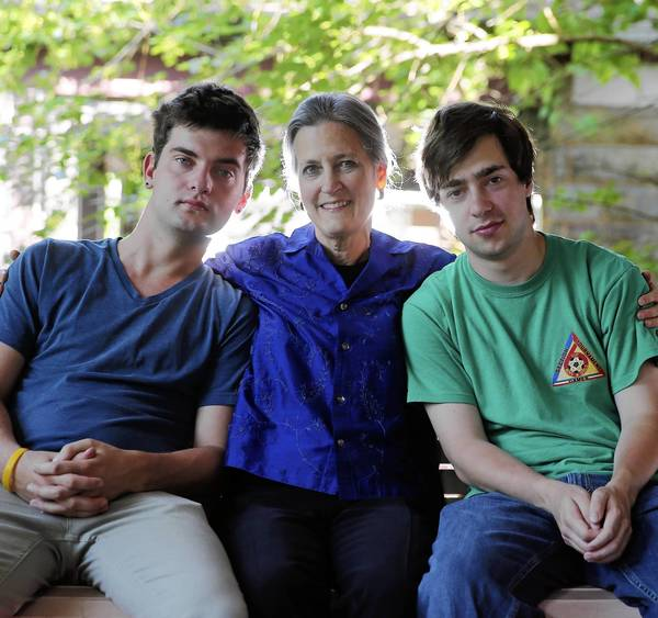 Kim Bobo at home with her twin sons Eric Coats (left) and Benjamin Bobo.